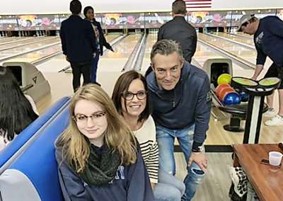 people smiling at bowling alley