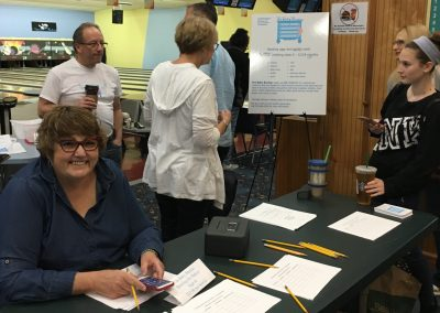 people at sign-in table at fundraiser